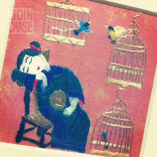 Bird cage embroidery inspired by traditional Chinese folk paintings.