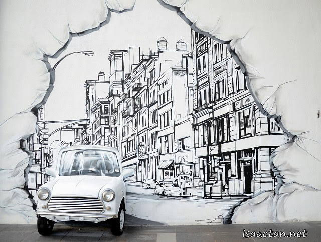 A car popping out from the street mural art