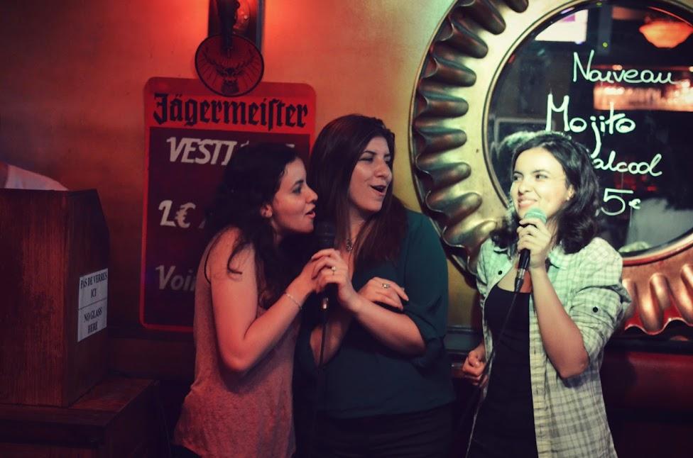 the serial shopper singing at karaoke night in paris