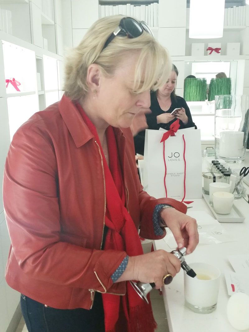 Jo Malone making a shot candle
