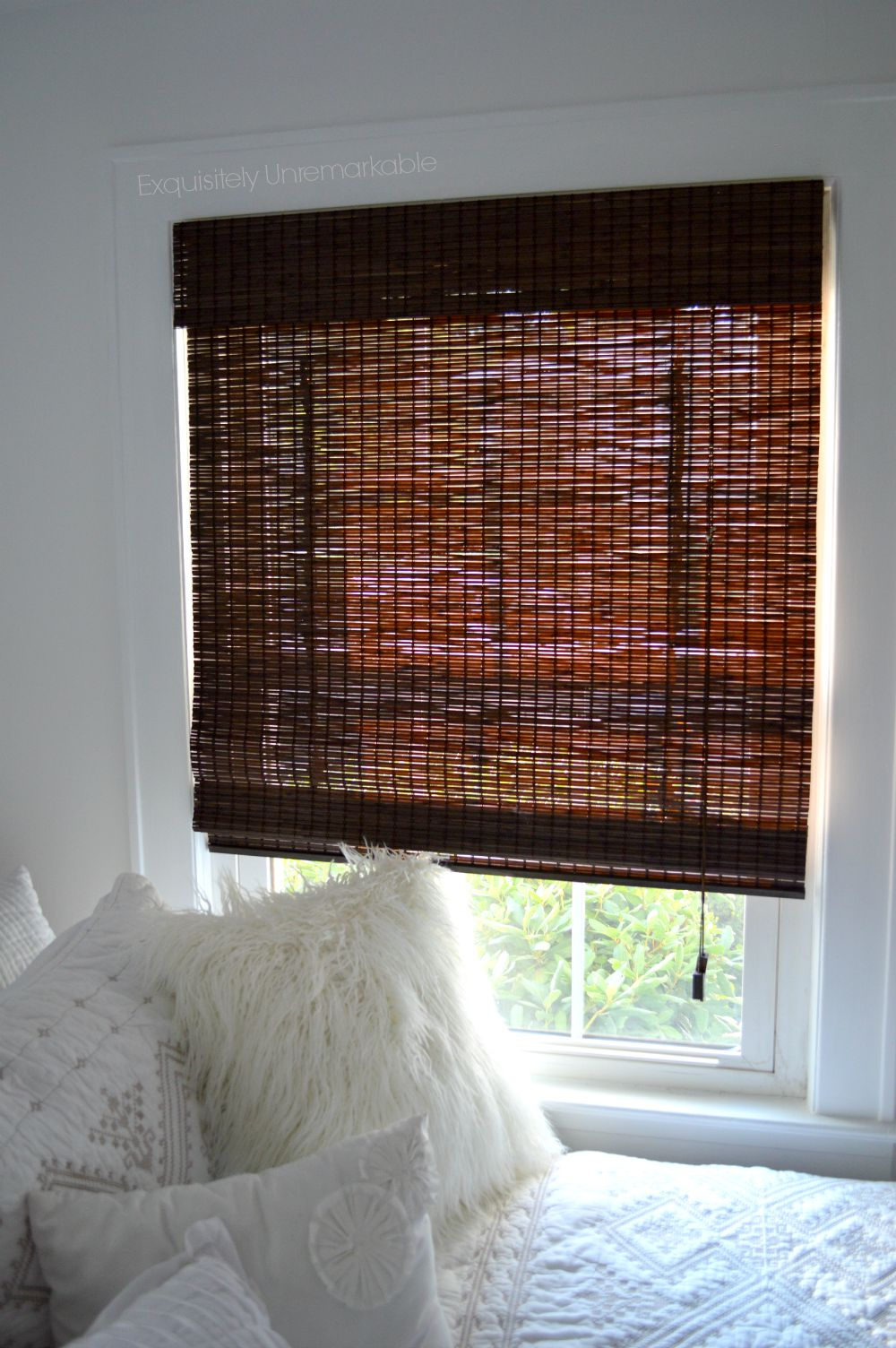 she has opted for a neutral earthly boho look which includes these really cool espresso colored bamboo matchstick blinds they are super pretty