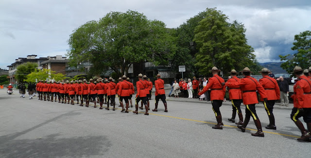 The RCMP parade leaves the ceremony while the families watch