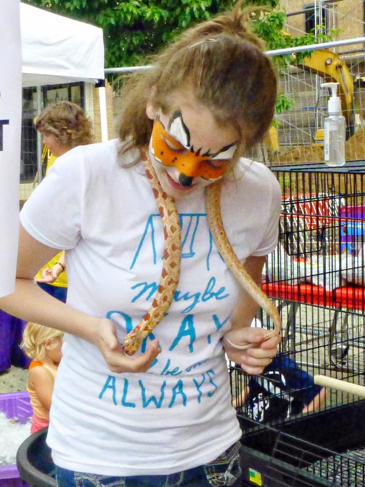 girl holding a snake