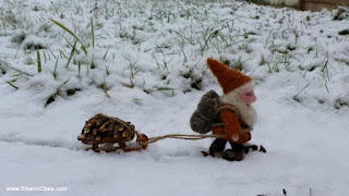 gnome pulling a sled in snow