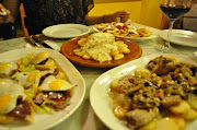 . same street as our flat; traditional Andalucia cooking; very good tapas .