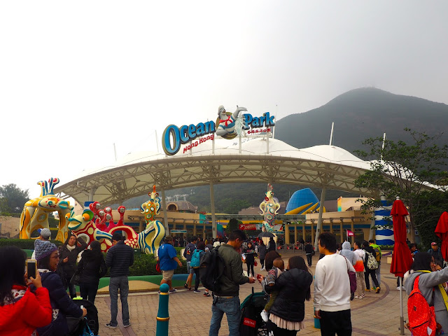 Ocean Park entrance with sign and sea animal statues, Hong Kong