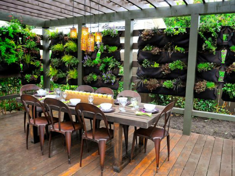 Coastal outdoor dining room with garden wall and copper chairs