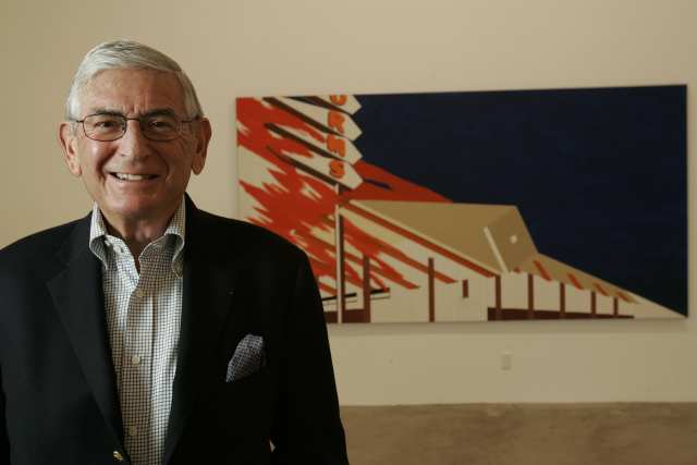 billionaire art collect Eli Broad with Ed Ruscha painting of burning Norm's restaurant