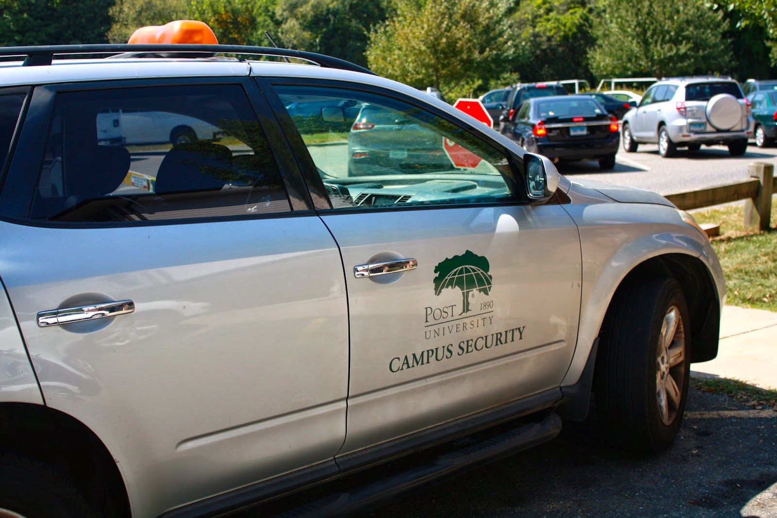 Photo of parked Post University campus security car.