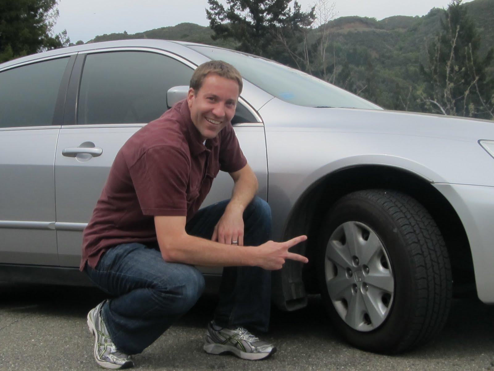 Guy posing with car