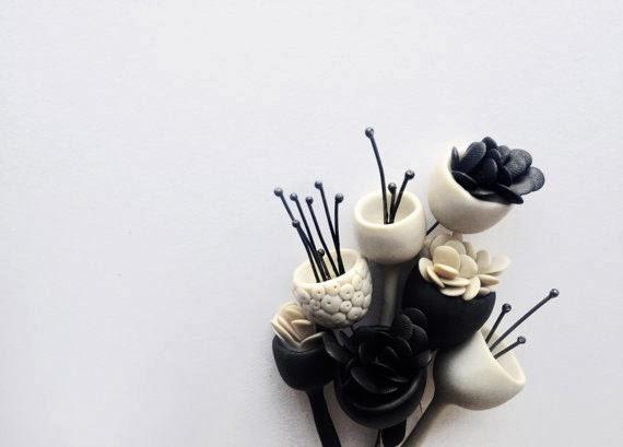 http://www.etsy.com/listing/119388102/organic-minimal-contemporary-polymer