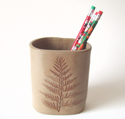 pottery pencil cup with an impression of a fern