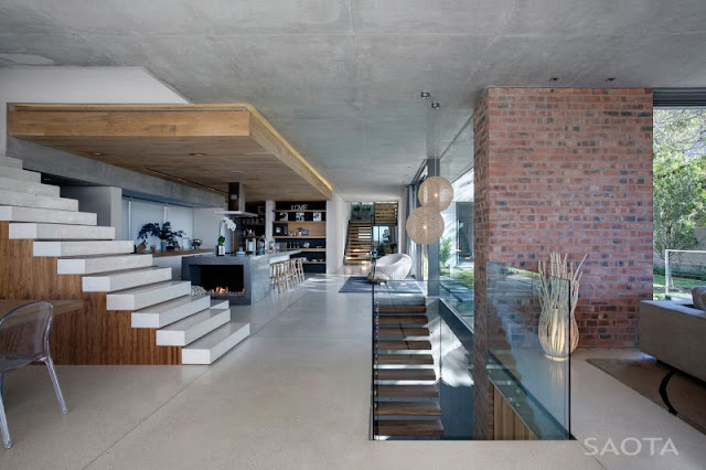 Photo of interiors of the Glen House showing modern kitchen along with the staircase to the fist floor and down to the basement