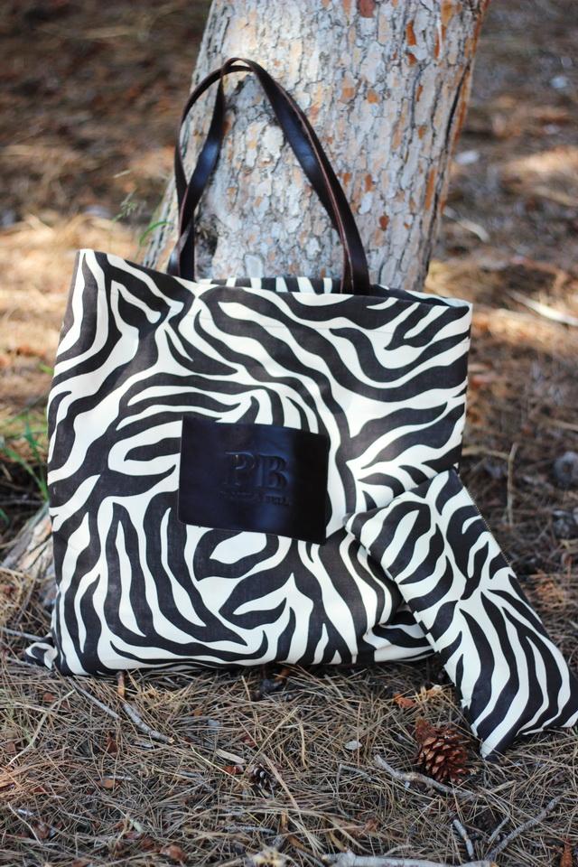 Bolso Calzados Sandra - Cartera + bolso animal print