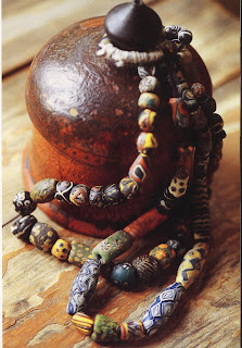 Antique glass beads, excavated in Afghanistan. Rare and valuable, these beads were blown and decorated with colors and motifs taken from the earth.