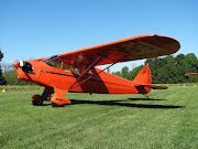 Piper J5 Cub Cruiser with a hardtomiss paint job (triple airplanes small)
