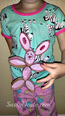 kid holding bunny toilet paper roll craft