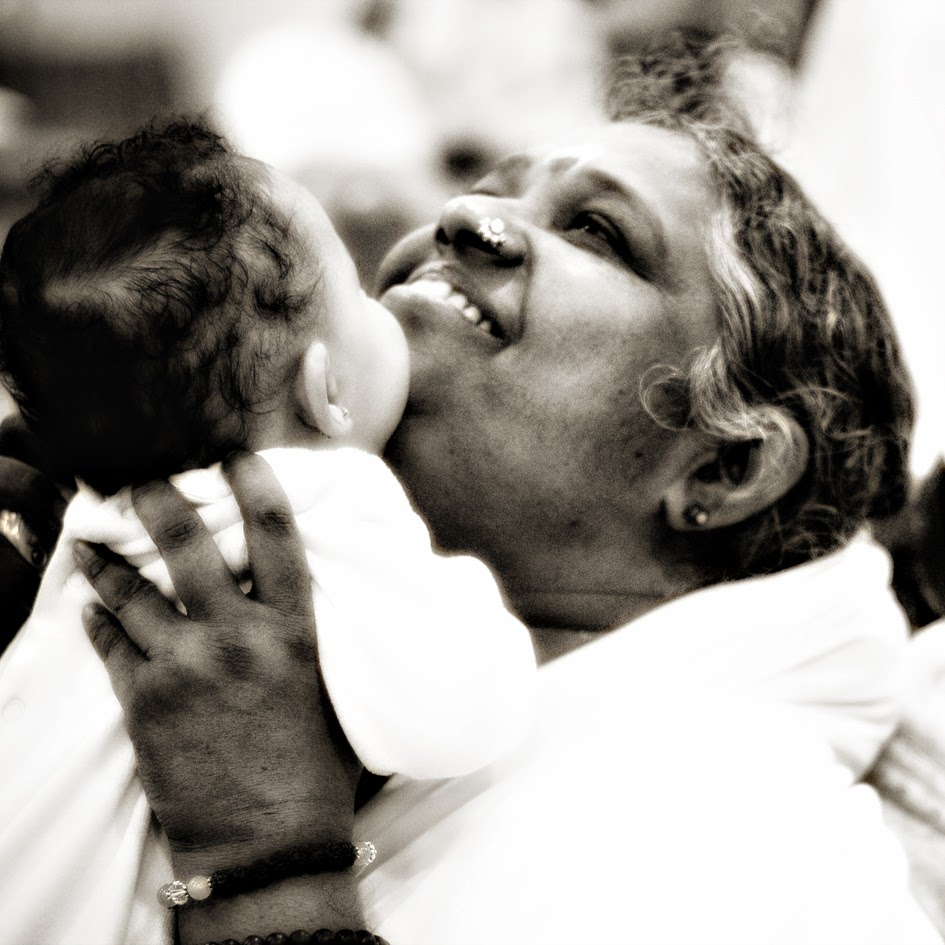 Mother Amma Hugging Saint
