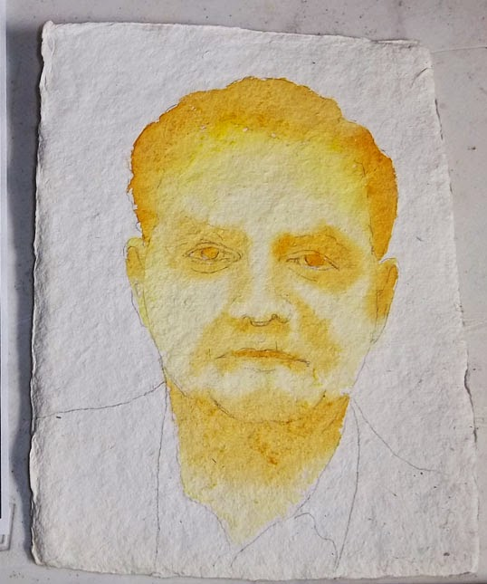 Gold watercolor underpainting for the sketch of a man done for Illustration Friday: Golden.