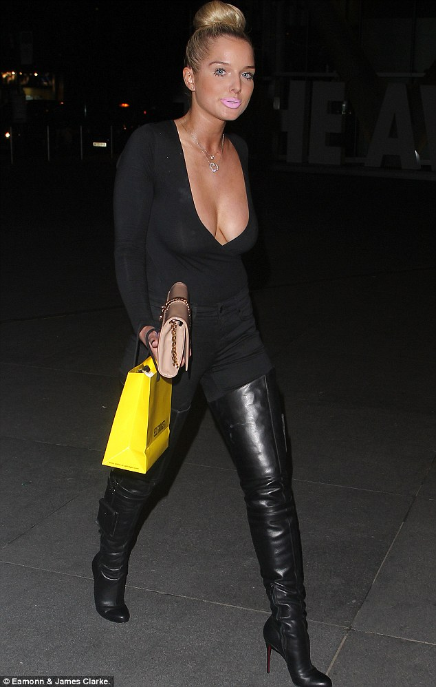 Helen Flanagan flaunts low-cut top and thigh-high boots in ...