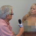 Reporter Lori Welbourne goes topless while taking an Interview with Canadian Mayor