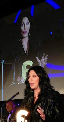 Cher at The Attitude Awards; Graham Norton can be seen in the background