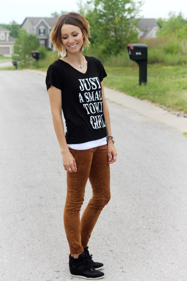 Black and white graphic tee, camel jeans and wedge sneakers