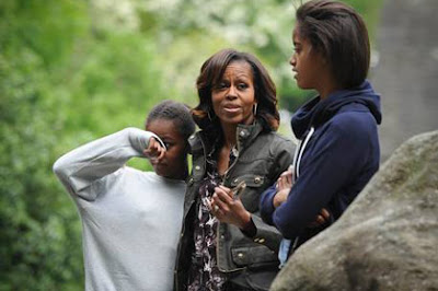 First Lady Michelle Obama, (C) accompanied by her two daughters, Sasha (L) and Malia (R), visit Glendalough in the Wicklow Mountains National Park in Ireland, on June 18, 2013.