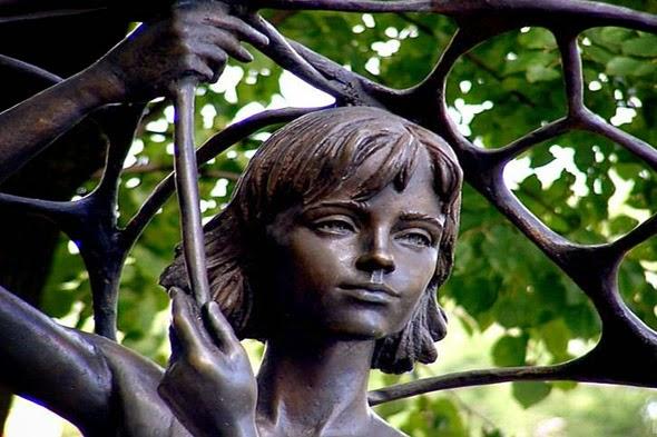 Statue Girl with an Umbrella in Mihailovskiy Park in Minsk