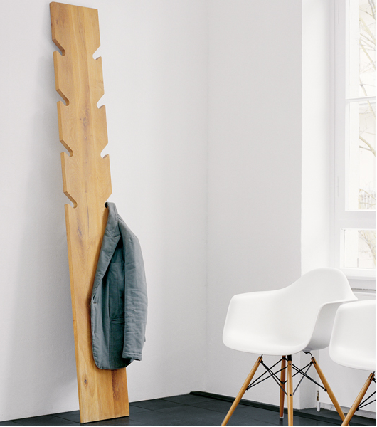 coat rack, wood, leans against