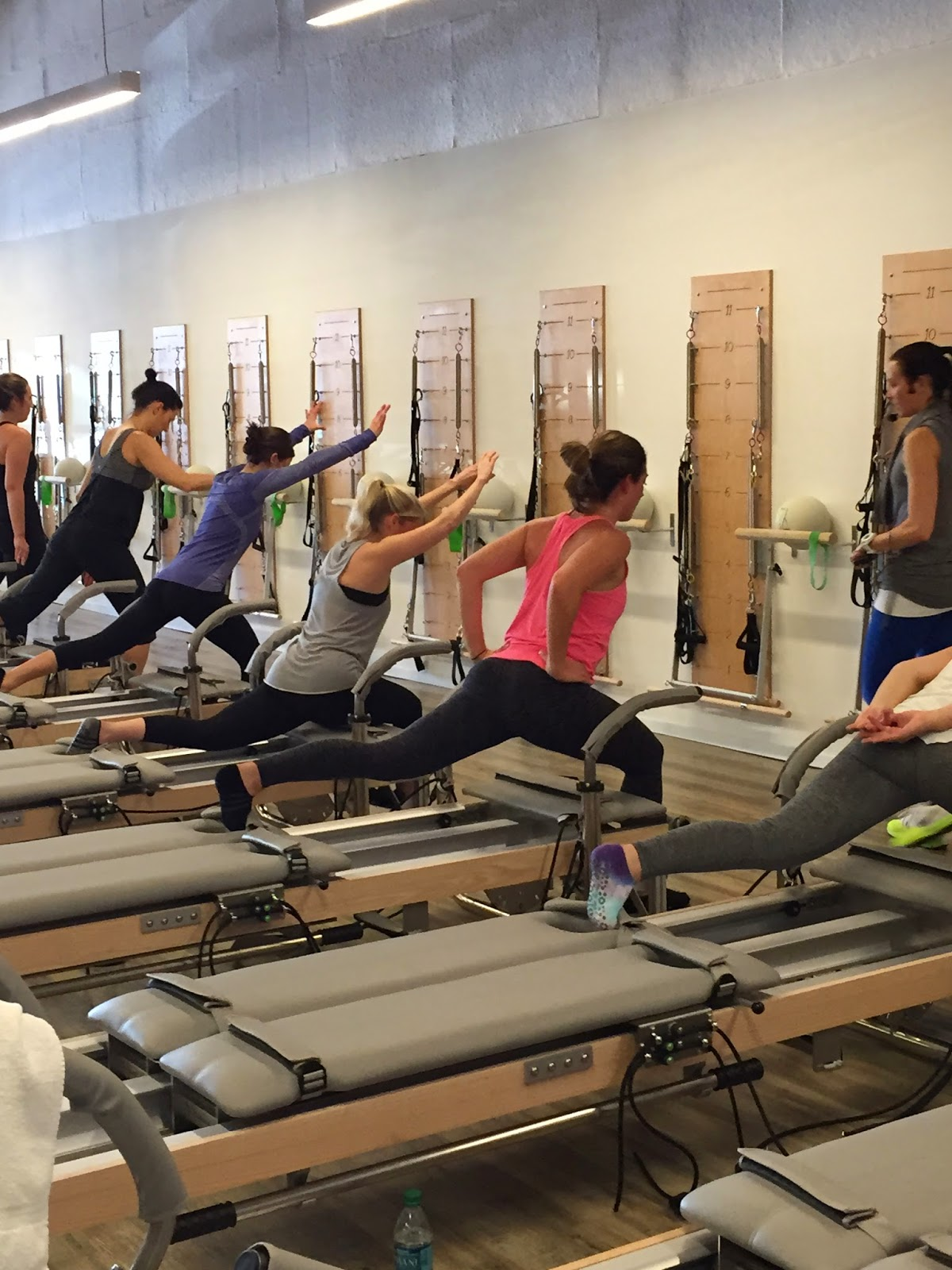 reverse lunges on reformer, pilates body class