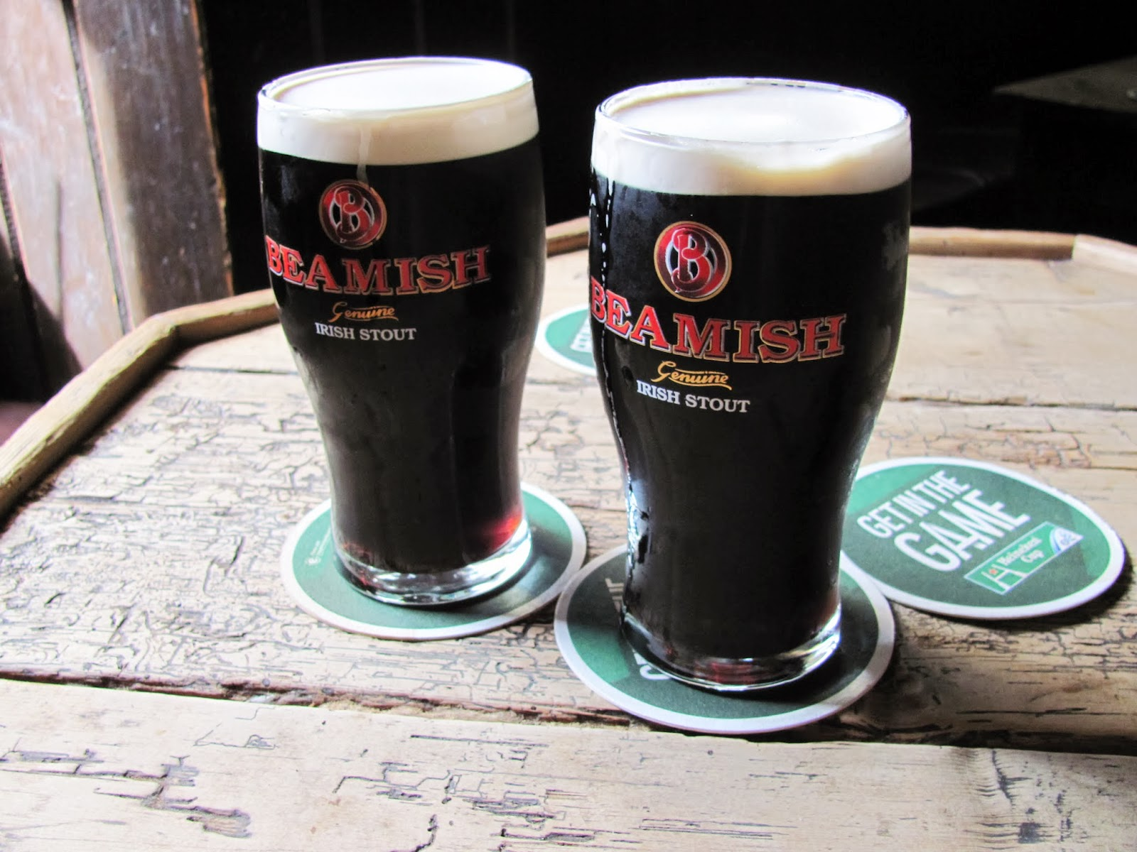 Two pints of Beamish Irish Stout on an empty whiskey barrel at Ciss Madden's at Kiely's of Donnybrook, Dublin, Ireland