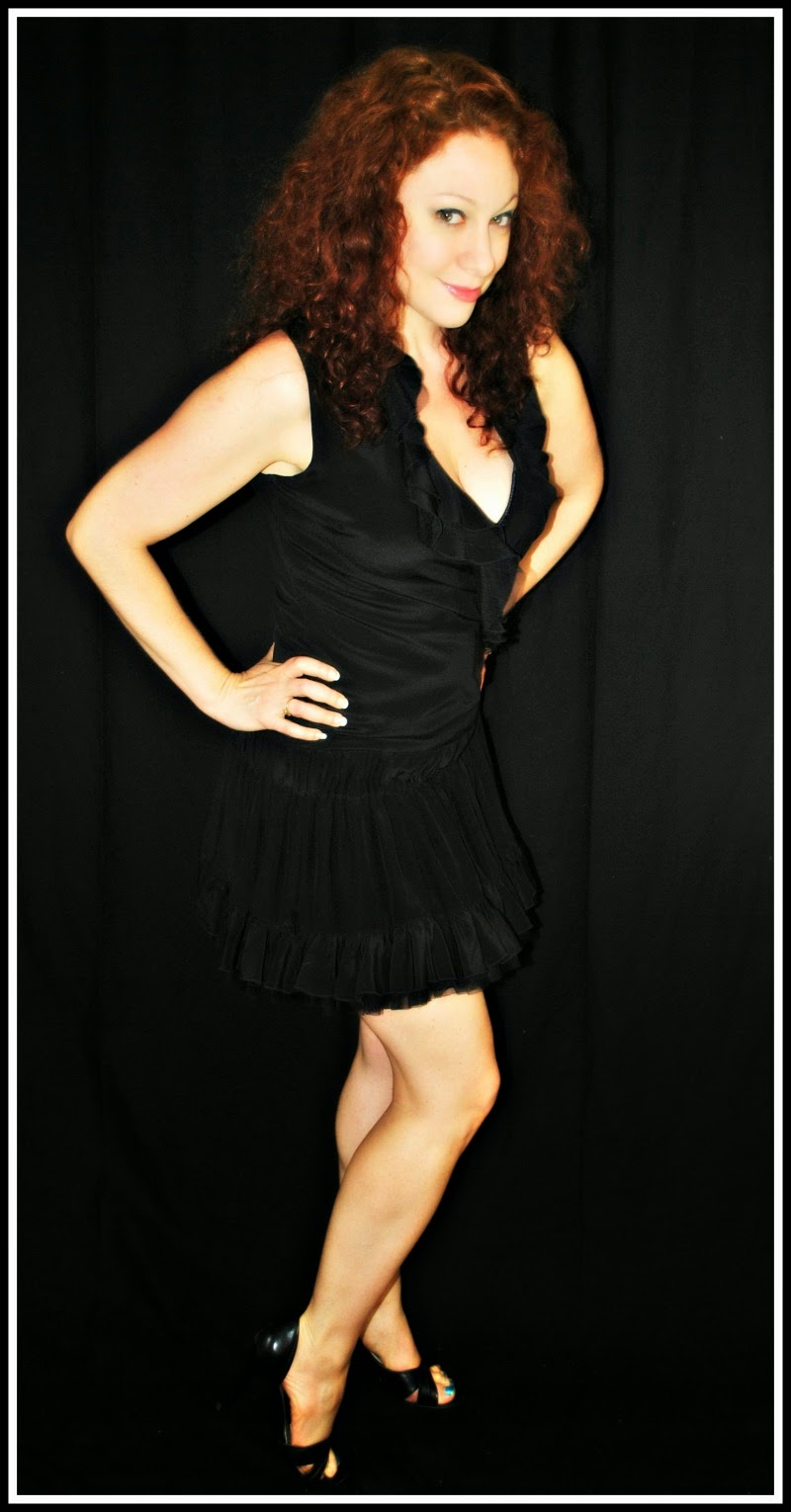 http://www.lendingluxury.com/black-silk-ruffle-dress.html