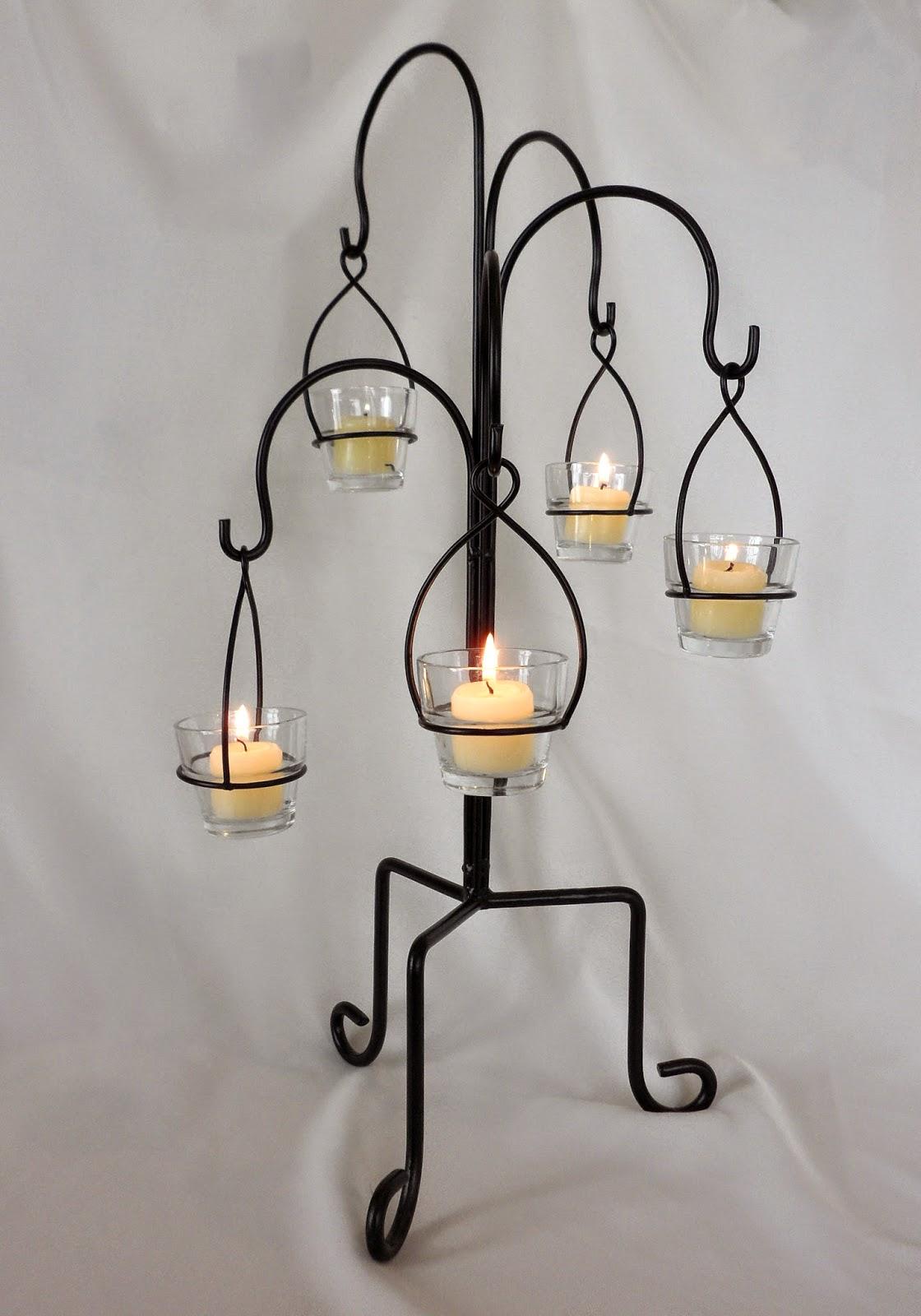 Planning tip 15 diy wedding centerpieces elite events for Hanging votive candles