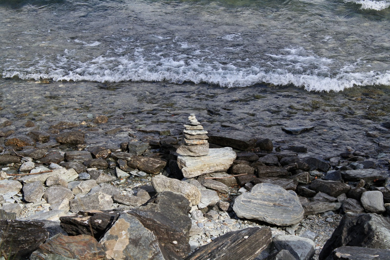 Stacked stones on the shores of Lake Wakatipu, Queenstown, South Island.