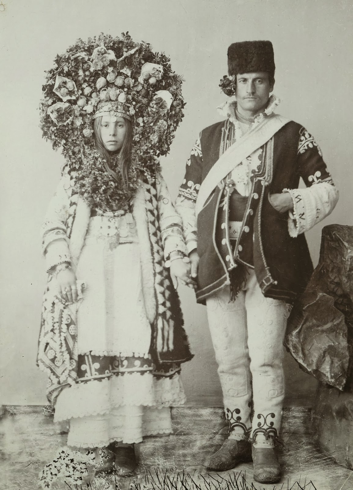 Local fashion: Traditional wedding costume and headdress of Europe