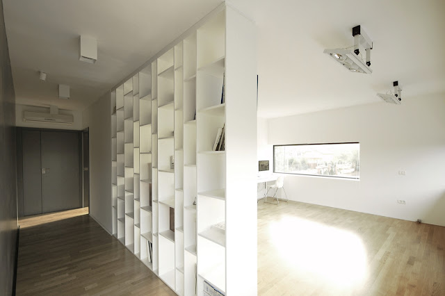 Book shelf used as a wall