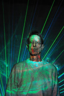 Ivan Dryer headshot with laser effects