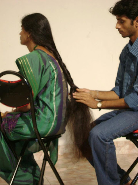 long hair braiding by her husband