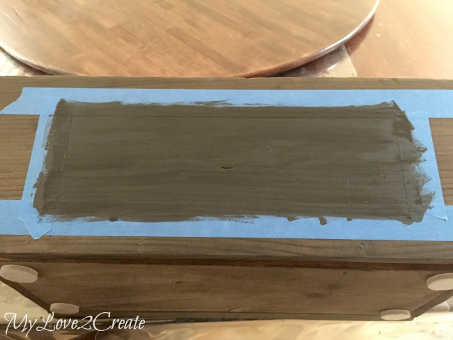 adding a simple chalkboard label to a crate with painters tape and chalkboard paint