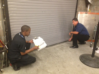 Metoyer trains an associate on physical security.