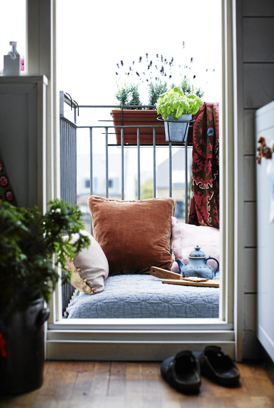 Small balcony with cushy floor pillow
