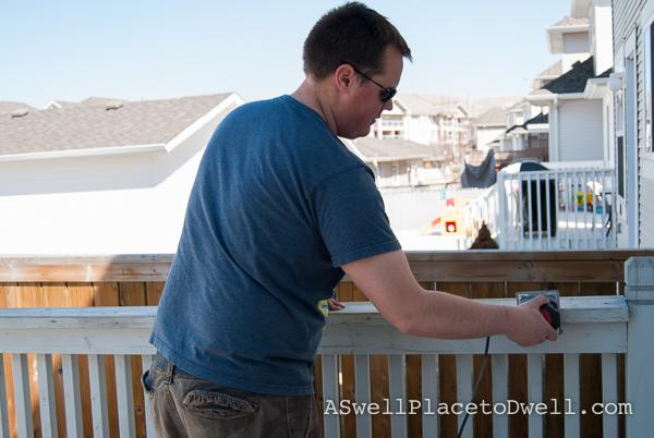 sanding the railings