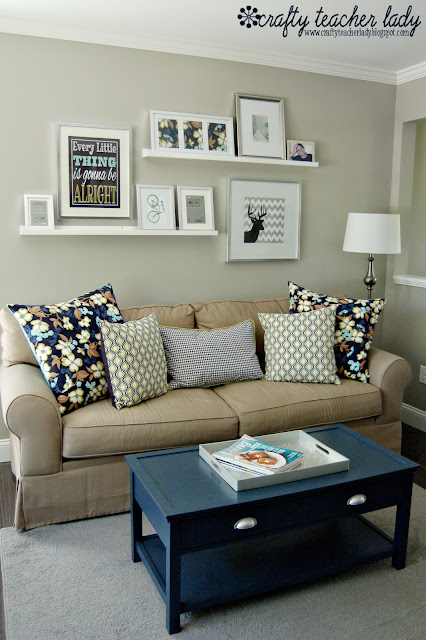 Gallery Wall and navy blue coffee table living room decor