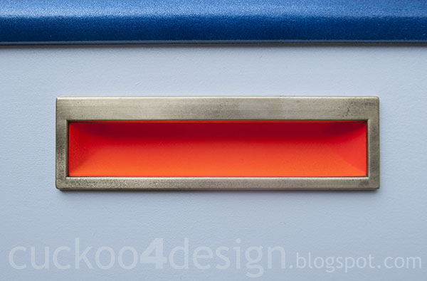 orange, metallic blue, white and gold painted drawer detail