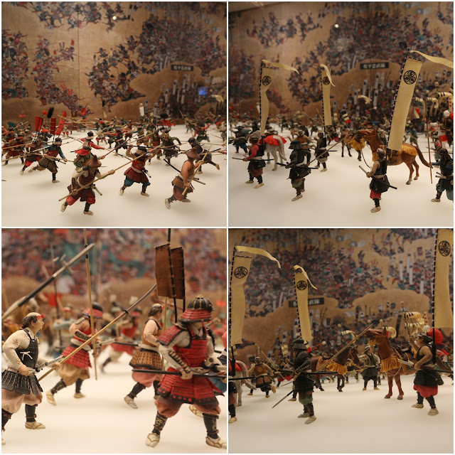 Miniature troops are arranged to tell the historical story during the Japanese war at Osaka Castle in Japan