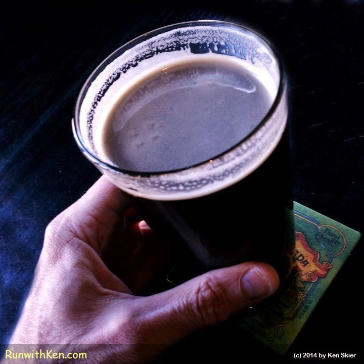 Ken Skier, the Running Photographer, lifts a glass of Cape Ann Fisherman's Red Bliss Potato Stout and makes a toast to runners who will be running the 2014 Boston Marathon.