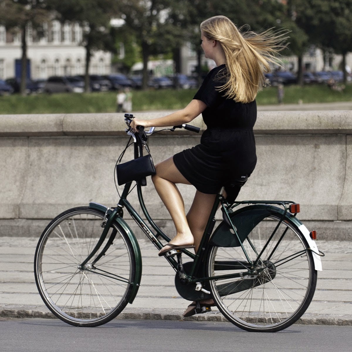 Fashionably dressed women go to work on bikes