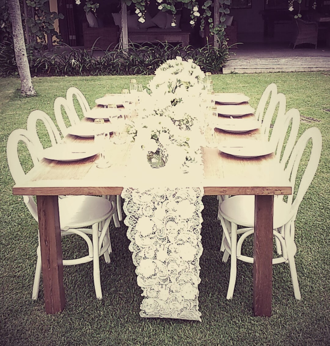 natural light dining table with white bentwood chairs