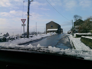 Snow cleared from the lane and the car.